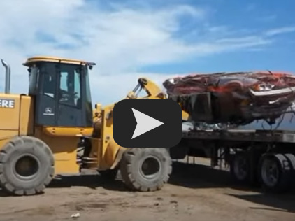 loading crushed cars